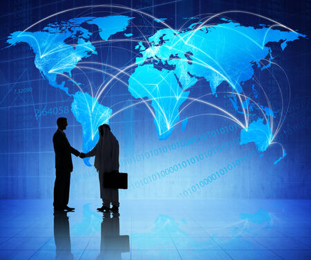 Multi-Ethnic Businessmen Shaking Hands with a Global Communication Background photo