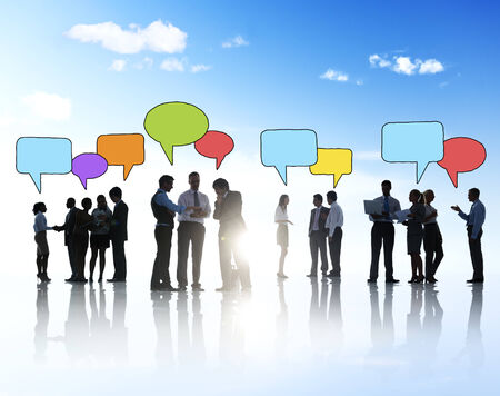 Silhouettes of Business People Outdoors and Speech Bubbles photo