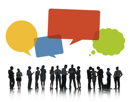 Silhouettes of Business People Discussing with Speech Bubbles photo
