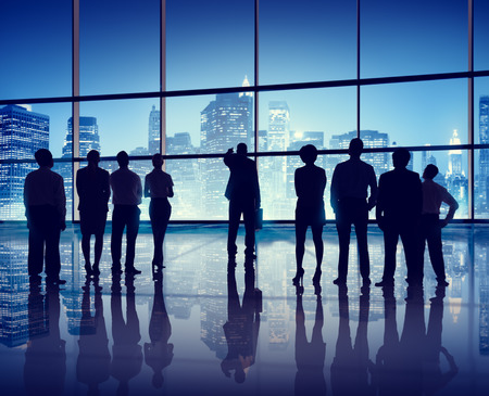 Silhouettes of Business People in an Office Building photo