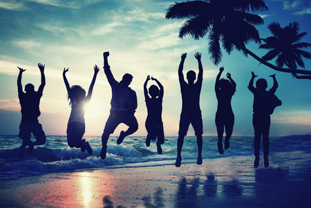 excitement: Young People Jumping with Excitement on the Beach Stock Photo