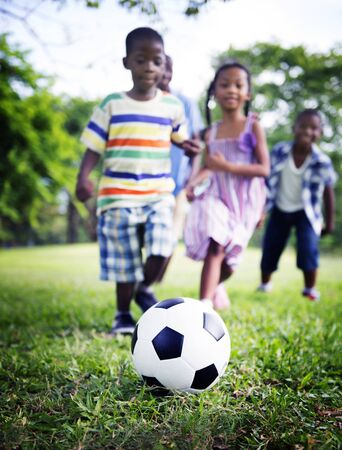 kids football: African Family Happiness Holiday Vacation Activity Concept