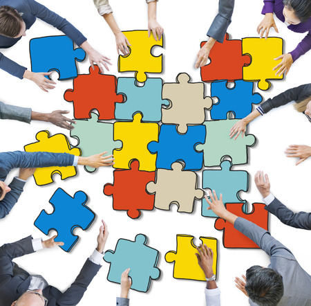 arms outstretched: Group of Business People Forming Jigsaw Puzzle Stock Photo