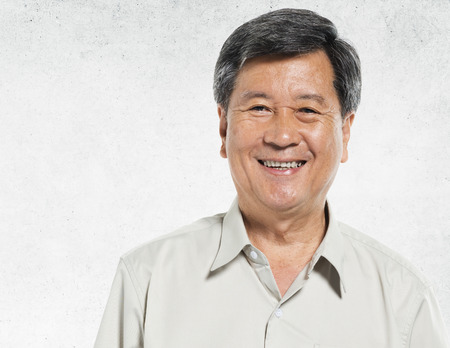 one senior: Asian Man Portrait Concrete Wall Background Concept