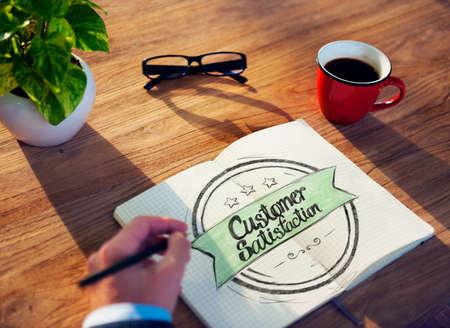 costumer: Businessman Writing the Words Costumer Satisfaction