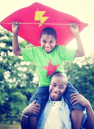 piggyback: African Father and Son Piggyback Playing Concept