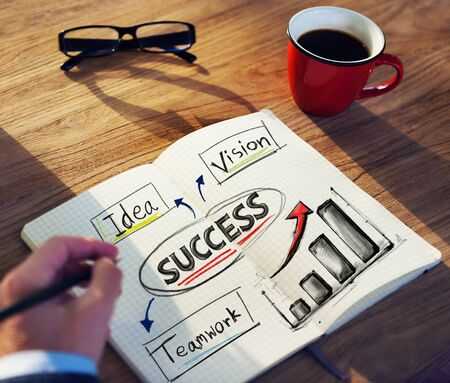 feasibility: Man with a Note and Success Concept Stock Photo