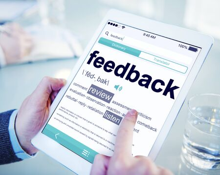 survey: Man Reading the Definition of Feedback
