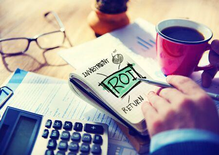 Businessman Notepad Roi Word Concept photo