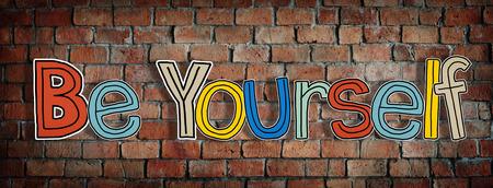 actitud positiva: Sea usted mismo y la pared de ladrillo en la Vuelta Foto de archivo