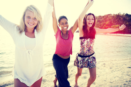people holding hands: Women Fun Beach Girls Power Celebration Concept Stock Photo