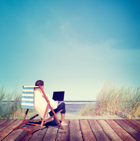 laptop: Businessman Working Summer Beach Relaxation Concept Stock Photo