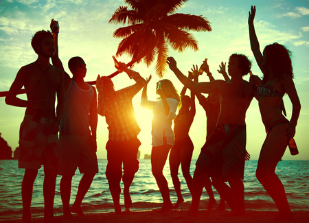 people partying: Silhouettes of Diverse Multiethnic People Partying Stock Photo