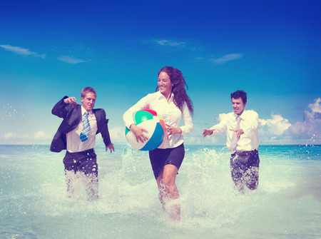 Business People Fun Playing Beach Travel Concept photo