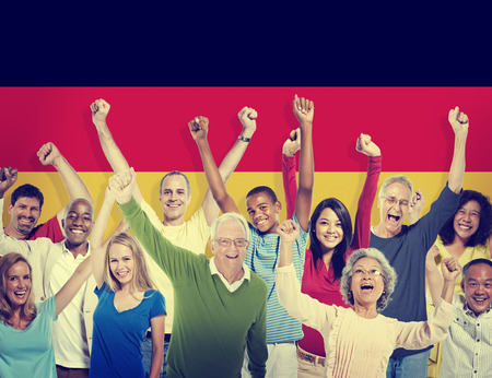 german ethnicity: Multi-Ethnic People Arms Raised German Flag Background Concept