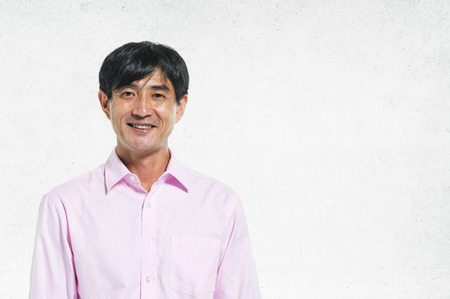 Asian Man Portrait Concrete Wall Background Concept