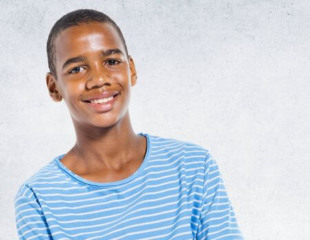 african boy: African Descent Portrait Concrete Wall Background Concept