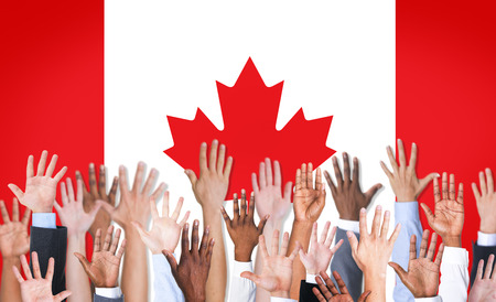 canada flag: Reach Hands Raised Canada Flag Diverse Ethnic Concept Stock Photo