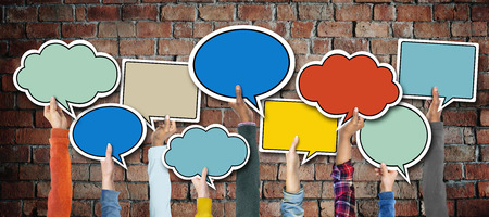 talking: Group of Hands Holding Speech Bubbles Stock Photo