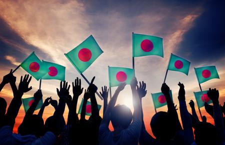 national flag bangladesh: Silhouettes of People Holding Flag of Bangladesh