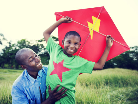 kites: African Family Happiness Holiday Vacation Activity Concept