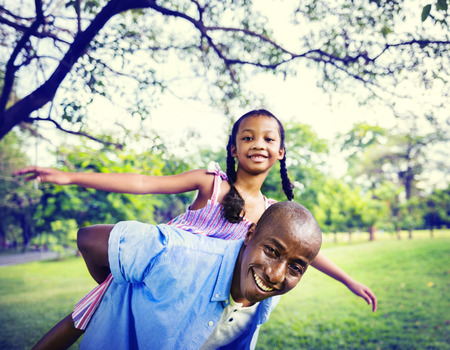 dad and daughter: African Family Happiness Holiday Vacation Activity Concept