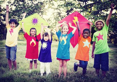multi age: Children Playing Kite Happiness Bonding Friendship Concept