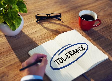 understand: Businessman Writing the Word Tolerance