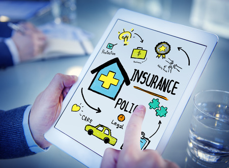 insurance policy: Businessman Insurance Policy Digital Deviecs Concept Stock Photo