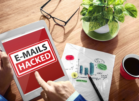 hacked: E-mails Hacked Warning Digital Device Wireless Browsing Concept