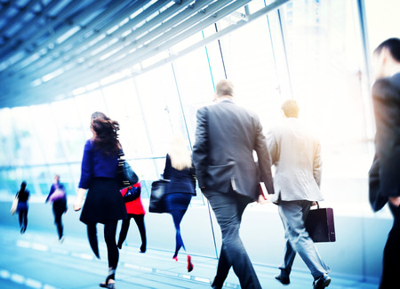 white people: Business People Walking Commuter Travel Motion City Concept Stock Photo