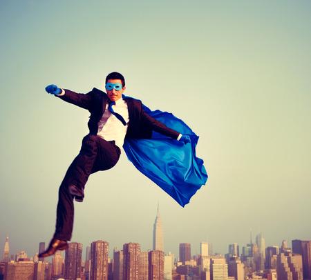 energetic: Superhero Energetic Businessman Cityscape Concept Stock Photo