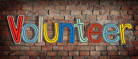 volunteer: Volunteer and Brick Wall in the Background