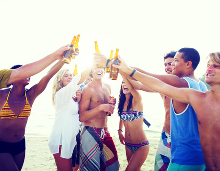 guy on beach: Friends Beach Party Drinks Toast Celebration Concept