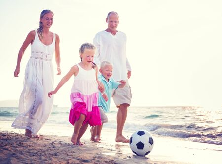 Family Running Playful Vacation Beach Holiday Concept photo