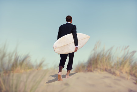 leisure sports: Businessman with Surfboard Going to the Beach Stock Photo