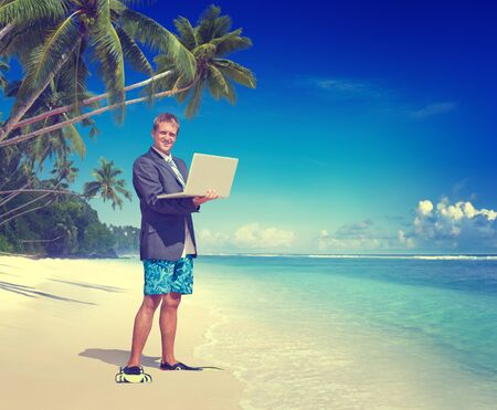 board shorts: Businessman Working Beach Summer Vacation Travel Concept Stock Photo