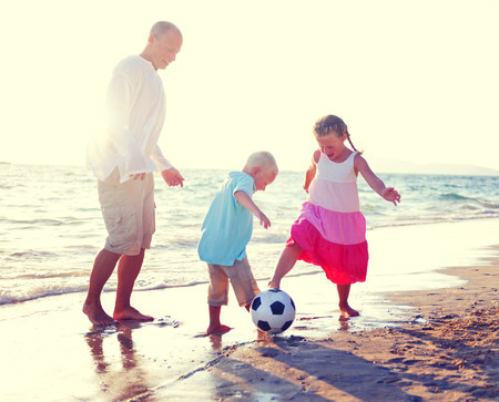 getting away from it all: Father Daughter Son Beach Fun Summer Concept