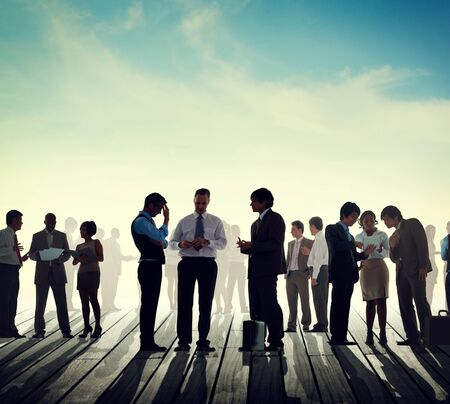 lit: Back Lit Business People Discussion Skyline Concept Stock Photo