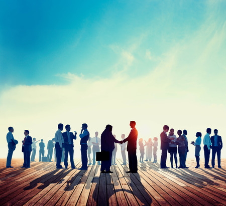 meeting together: Back Lit Business People Discussion Skyline Concept Stock Photo