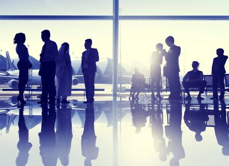 business travel: Group of People Airport Business Travel Communication Concept Stock Photo
