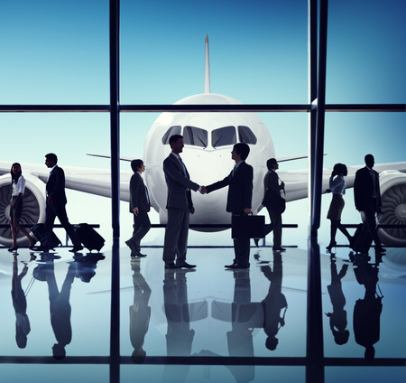 Business People Travel Handshake Airport Concept 版權商用圖片