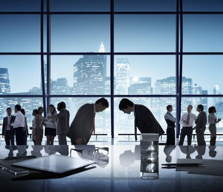 bowing: Business People Bowing Discussion Communication Cityscape Meeting Concept Stock Photo