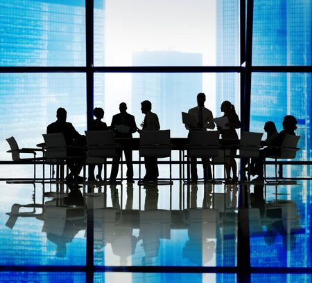 building work: Silhouette Group of Business People Meeting Concept Stock Photo