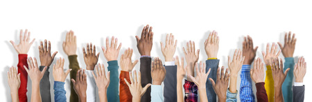 diverse hands: Group of Multiethnic Diverse Hands Raised Stock Photo