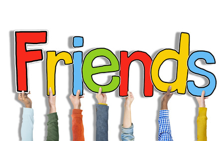 Multiethnic Group of Hands Holding Letter Friends Stock Photo