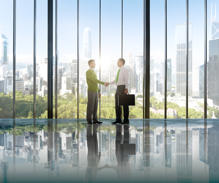 environmental conservation: Businessmen Environmental Conservation Concepts Hand Shake Deal Partnership Stock Photo