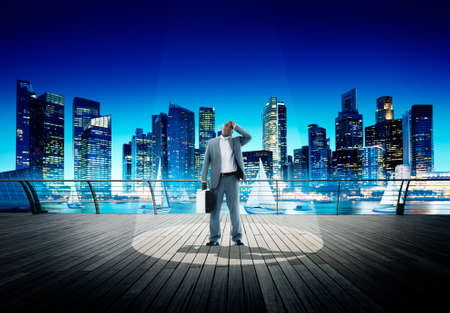 weary: Spotlight Businessman Weary Contemplation Cityscape Concept