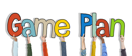 game plan: Diverse Hands Holding the Words Game Plan Stock Photo