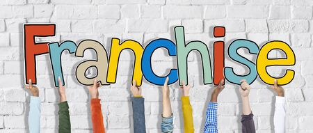 franchising: Diverse Hands Holding the Word Franchise Stock Photo